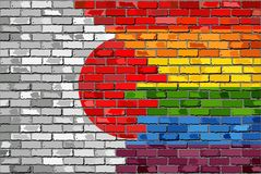 Brick Wall Japan and Gay flags Stock Photo