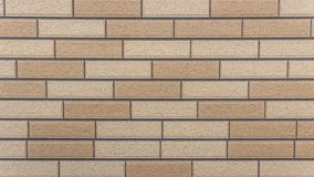 Brick wall lined horizontally from two types of bricks royalty free stock image