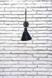 Brick wall with lamp Stock Photos