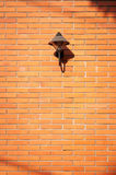 Brick wall with a lamp free space Stock Photos