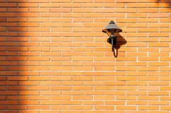 Brick wall with a lamp free space Stock Image
