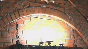 Brick wall with lamps, deer antlers, two guns stock video footage