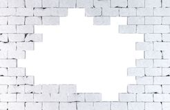 Brick wall with a large hole. Isolated. Contains clipping path Royalty Free Stock Photos