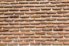 Brick wall with a large layer of mortar. As a background Royalty Free Stock Photography