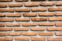 Brick wall with a large layer of mortar. As a background Stock Photography