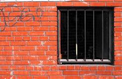 Brick wall, lattice at window Royalty Free Stock Photo