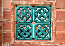 Brick wall and latticework window. A red brick wall and Asian style latticework window Royalty Free Stock Image