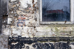 Brick wall with layers of weathered stucco. Royalty Free Stock Photos