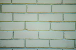 Brick wall in light green color. stock image