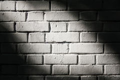 Brick wall with light spot Stock Images