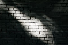 Brick wall with light spot Royalty Free Stock Photos