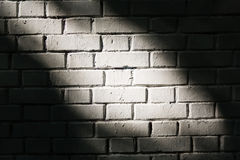 Brick wall with light spot Royalty Free Stock Photo