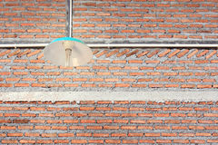 Brick wall and lighting decor Stock Images