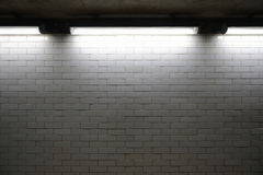 Brick wall with lights Stock Photography