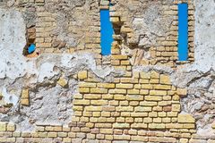 Brick wall with loopholes of old fortress Royalty Free Stock Image