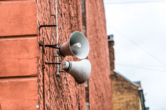 Brick wall with loud-speakers Stock Photos