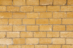 Brick wall made of light yellowish stones Royalty Free Stock Images
