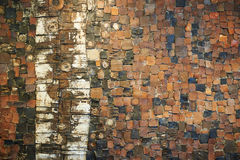 The Brick Wall. The wall made from red and pieces of stone Stock Images