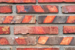 BRICK WALL. THE WALL IS MADE OF BRICK RED, THE SURFACE IS WELDED HEAT NOT UNIFORM BECAUSE OF THE BRICKS STACKED OVERLAP WHILE IN THE FURNACE. SONGKHLA, THAILAND Royalty Free Stock Image