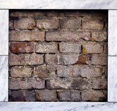 Brick wall with marble frame. Detail off brick wall with marble frame Royalty Free Stock Images