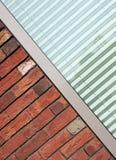 Brick wall meets modern Stock Photography