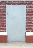 Brick wall with metal door Royalty Free Stock Images