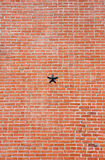 Brick Wall with Metal Star royalty free stock image