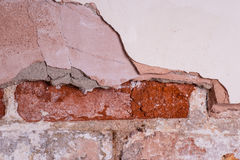 Brick wall with missing and damaged plaster Royalty Free Stock Images
