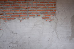 A brick wall mixed with plaster unfinished Stock Photo