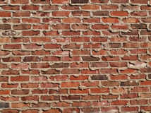 Brick Wall With Mortar Oozing From the Cracks. Red and brown brick wall with mortar oozing from between the cracks Stock Image