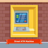 Brick wall mounted outdoor ATM machine Stock Photography