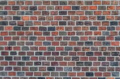 Brick wall multi-colored. Part wall with old bricks. Brick wall multi-colored. Part wall with old bricks, retro Style royalty free stock photo