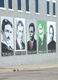 Brick Wall Mural. Mural of famous people. Nikola Tesla, Vannever Bush, Alan Turing, Claude Shannon, and Steve Jobs Stock Photography