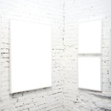 Brick wall in museum with frames Royalty Free Stock Photos