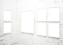 Brick wall in museum with frames Royalty Free Stock Images