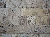 Brick wall, natural stone marble limestone. stock photos