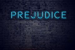 Brick wall and neon sign with text prejudice.  stock illustration