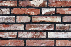 A brick wall newly fitted with concrete seam. Royalty Free Stock Photos