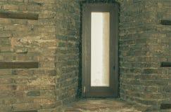 Brick Wall Niche. Door in niche of old brick wall stock images