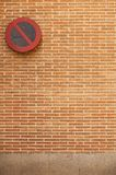Brick wall with no parking sign Stock Images