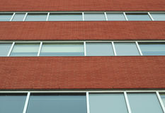 Brick wall office building horizontal windows business facade Royalty Free Stock Photo