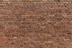 Brick wall of an old building of red terracotta color stock photo