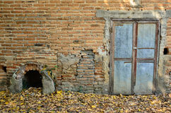 Brick wall with old door. Orange brick exterior wall of old house with old door Stock Image