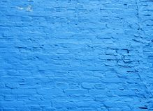 Blue brick wall with some peeling paint. Brick wall old that has been painted blue with some peeling paint used as background texture pattern Stock Image