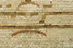 A brick wall of an old house with detail. Beige background Stock Photo