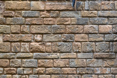 Brick wall of an old house on the street in Florence Stock Photo