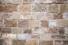 Brick wall of an old house on the street in Florence Stock Photography