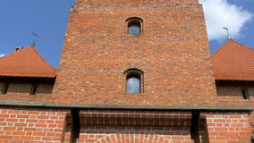 The brick wall of the old medieval castle in Lithuania GH4 4K UHD. The red brick wall of the old medieval castle in Trakai Lithuania very well built architecture stock video