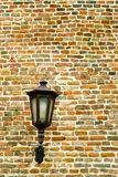 Brick wall with old metal lamp Royalty Free Stock Photo