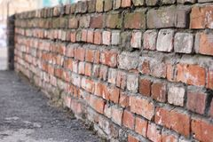 Brick wall of old red brick. Texture of stone and cement. Old paint. Rows and alternation stock images